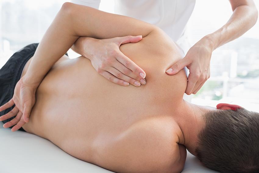 physiotherapist-massaging-man